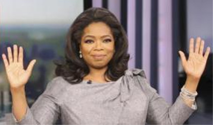 Oprah Winfrey waving both hands